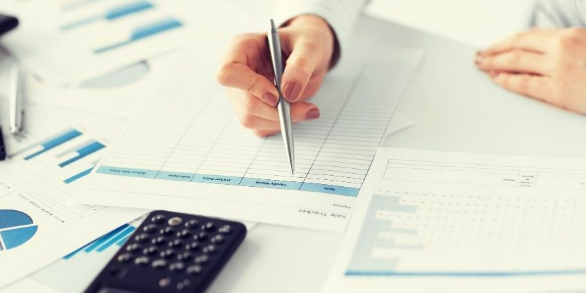 hand of bookkeeper updating financial records